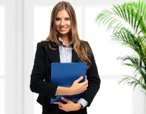 business woman standing with files